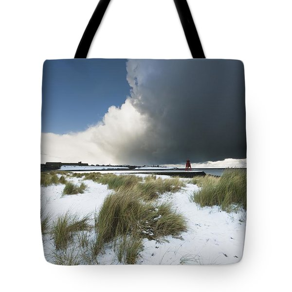 Dark Clouds And Blue Sky Over A Red Tote Bag by John Short