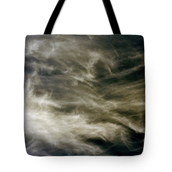 Tote Bag featuring the photograph Dirty Clouds by Clayton Bruster