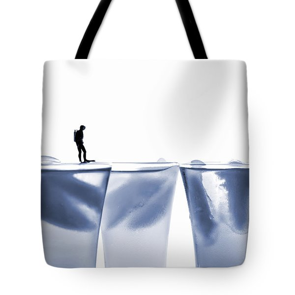 Diving In Ice Water Tote Bag by Paul Ge