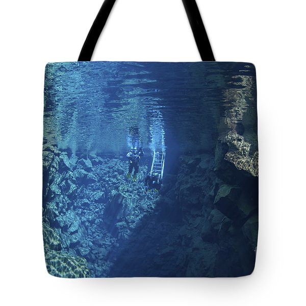 Dry Suit Divers Entering The Gin Clear Tote Bag by Mathieu Meur