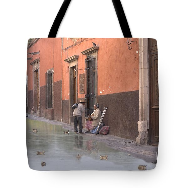 Tote Bag featuring the digital art Ducks Swimming On Calle Reloje by John  Kolenberg