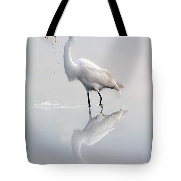 Tote Bag featuring the photograph Egret Eating Lunch by Dan Friend