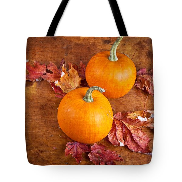 Tote Bag featuring the photograph Fall Decorative Pumpkins by Verena Matthew