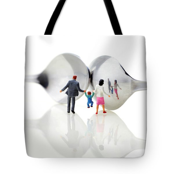 Family In Front Of Spoon Distoring Mirrors II Tote Bag by Paul Ge