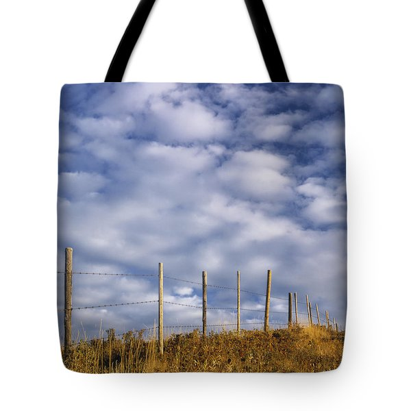 Fenceline In Pasture With Cumulus Tote Bag by Darwin Wiggett