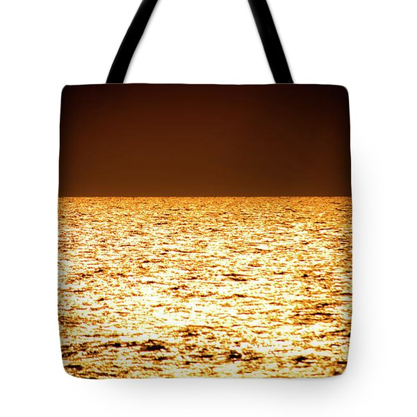 Tote Bag featuring the photograph Fiery Sunset Over The Sea by Michael Goyberg