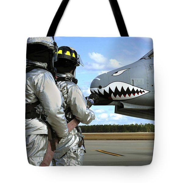 Firefighters Deploy A Fire Hose Tote Bag by Stocktrek Images