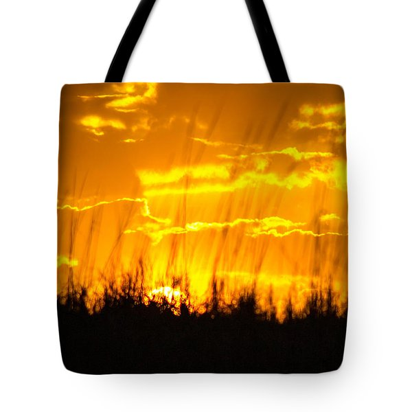 Tote Bag featuring the photograph Firey Sunset by Shannon Harrington