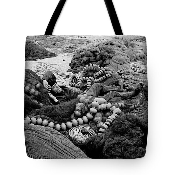 Fisherman Sleeping On A Huge Array Of Nets Tote Bag