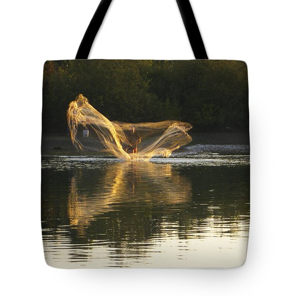 Fisherman Throwing His Net Tote Bag by Anne Mott