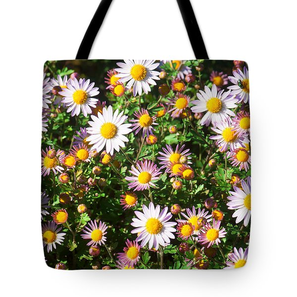 Tote Bag featuring the photograph Flower Assault by Jim Moore