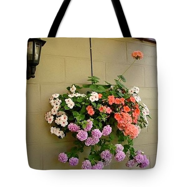 Tote Bag featuring the photograph Flower On Wall by Katy Mei