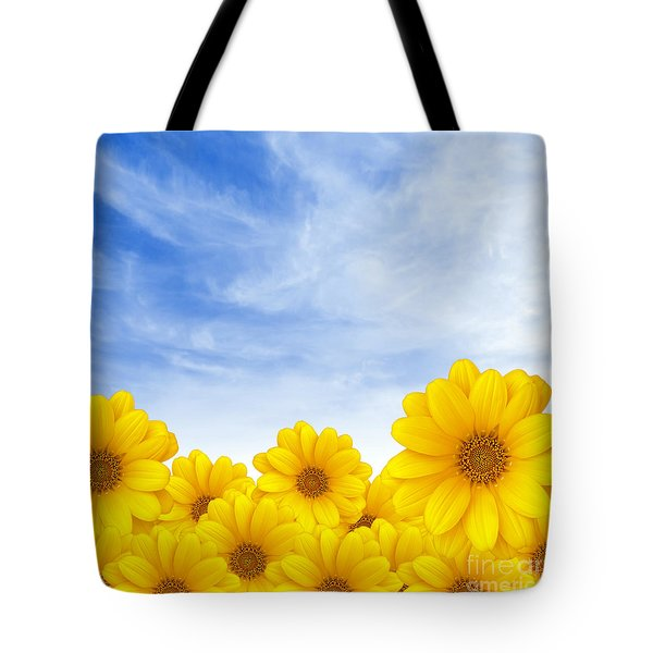 Flowers Over Sky Tote Bag by Carlos Caetano