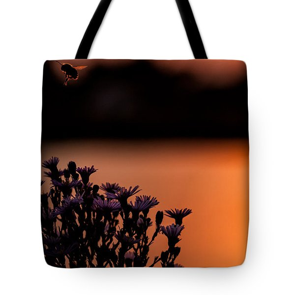 Tote Bag featuring the photograph Flying Home by Tom Gort