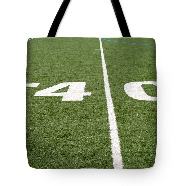 Tote Bag featuring the photograph Football Field Forty by Henrik Lehnerer