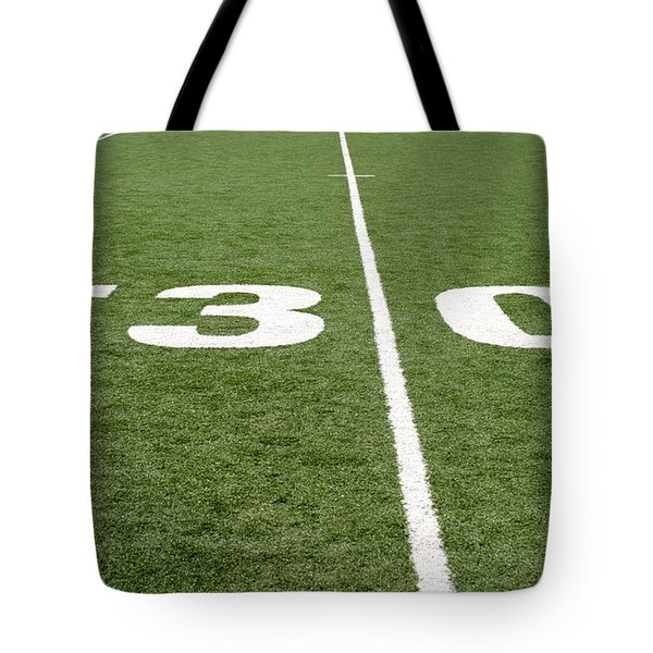 Tote Bag featuring the photograph Football Field Thirty by Henrik Lehnerer