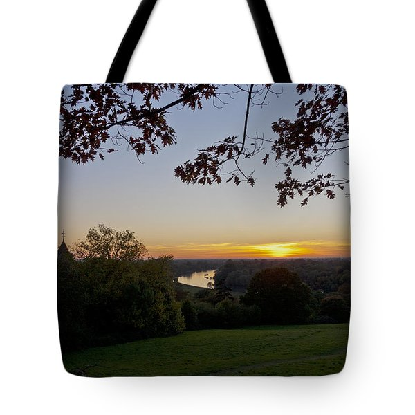 Tote Bag featuring the photograph Framed Sunset by Maj Seda