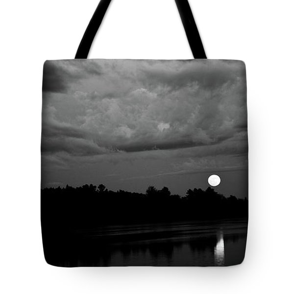 Tote Bag featuring the photograph Full Moon Rising by Greg DeBeck