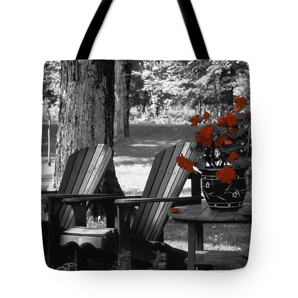 Garden Chairs With Red Flowers In A Pot Tote Bag by David Chapman