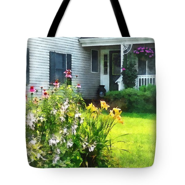 Garden With Coneflowers And Lilies Tote Bag by Susan Savad