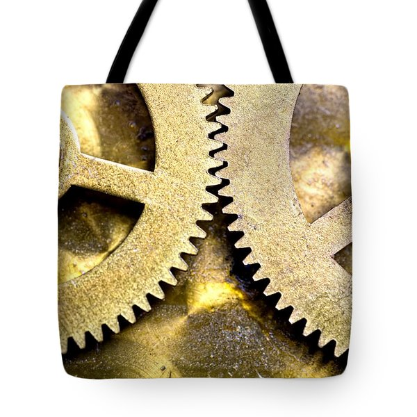 Tote Bag featuring the photograph Gears From Inside A Wind-up Clock by John Short