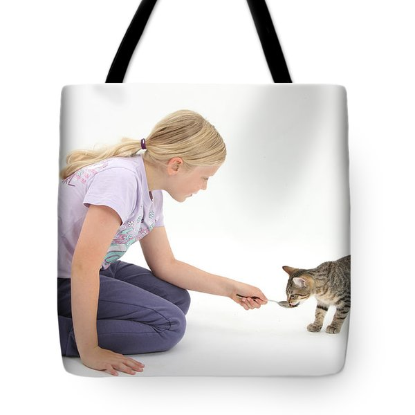 Girl Feeding Kitten From A Spoon Tote Bag by Mark Taylor