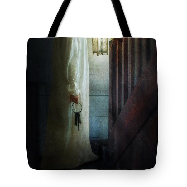 Girl On Stairs With Lantern And Keys Tote Bag by Jill Battaglia