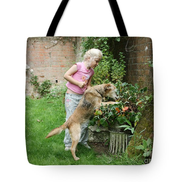 Girl Playing With Dog Tote Bag by Mark Taylor
