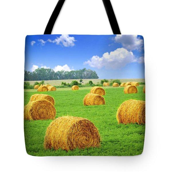 Golden Hay Bales In Green Field Tote Bag by Elena Elisseeva