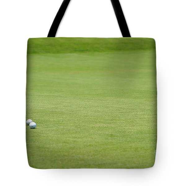 Golf Balls Near Flagstick Tote Bag by Henrik Lehnerer