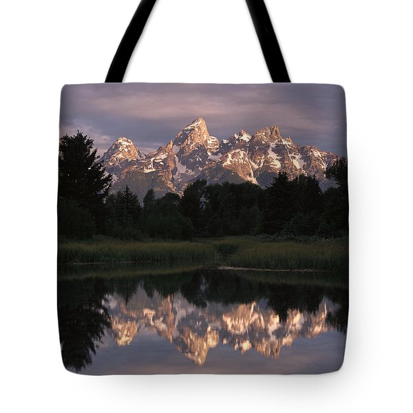 Grand Teton Range And Cloudy Sky Tote Bag by Tim Fitzharris