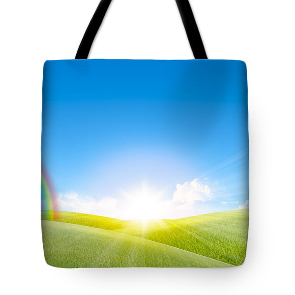 Grassland In The Sunny Day With Rainbow Tote Bag by Setsiri Silapasuwanchai