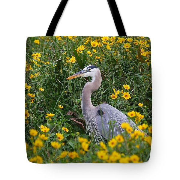 Great Blue Heron In The Flowers Tote Bag by Myrna Bradshaw