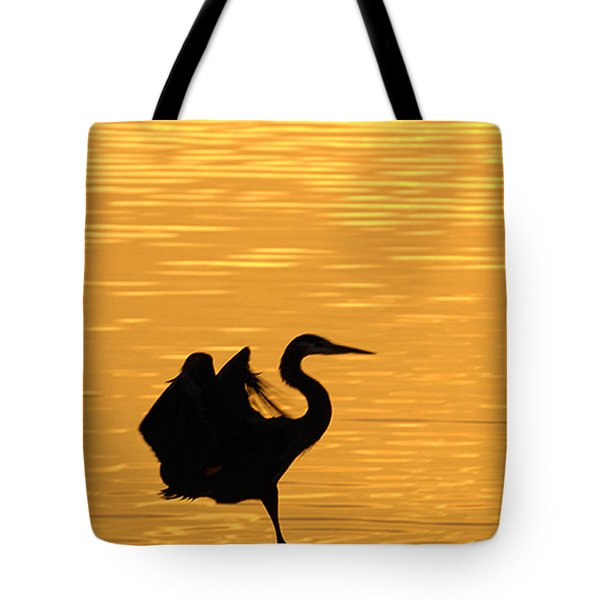 Tote Bag featuring the photograph Great Blue Heron Landing In Golden Light by Randall Branham
