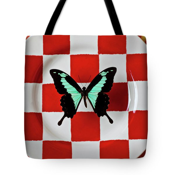 Green And Black Butterfly On Red Checker Plate Tote Bag by Garry Gay