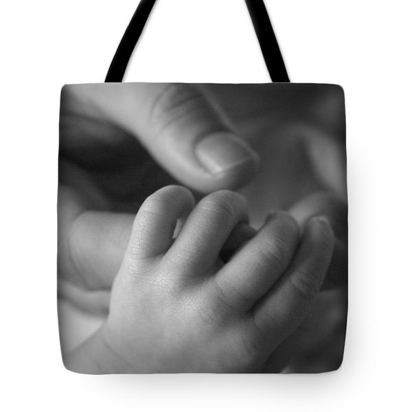 Tote Bag featuring the photograph Hands by Kelly Hazel