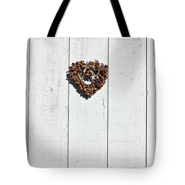 Heart Wreath On Wood Wall Tote Bag by Garry Gay