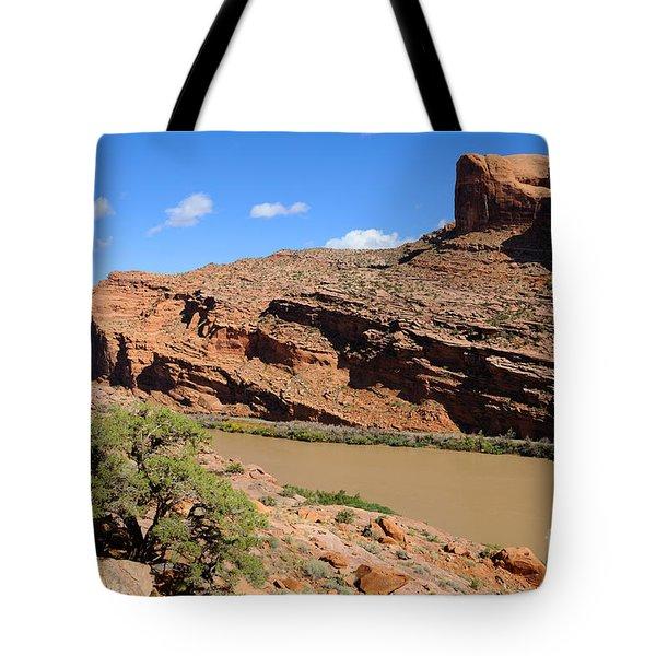 Hiking The Moab Rim Tote Bag by Gary Whitton