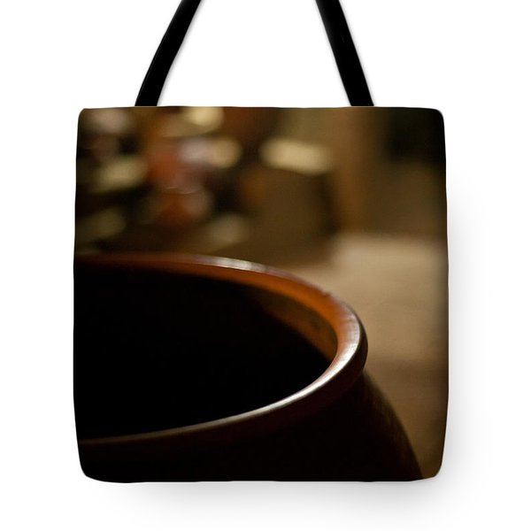 Holding Tote Bag by Mike Reid