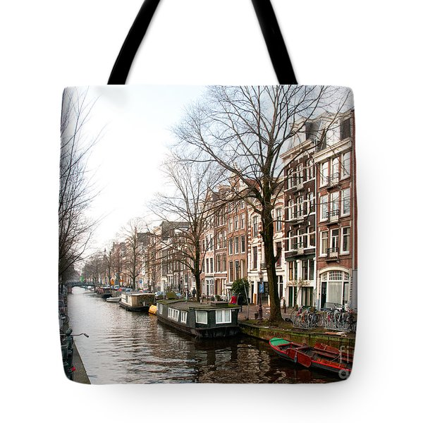 Tote Bag featuring the digital art Homes Along The Canal In Amsterdam by Carol Ailles