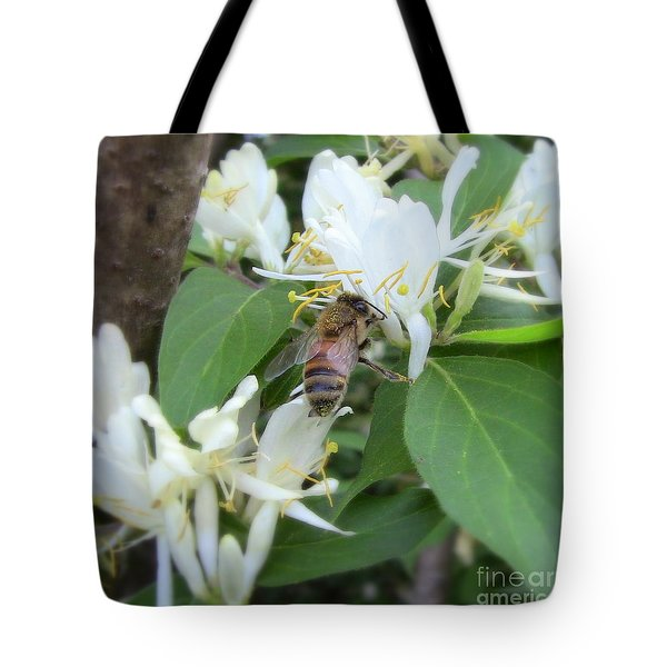 Tote Bag featuring the photograph Honeybee Collecting Pollen by Renee Trenholm