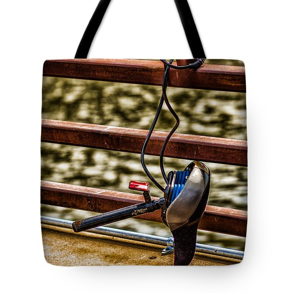Tote Bag featuring the photograph How Not To Lock Your Bike by Tom Gort