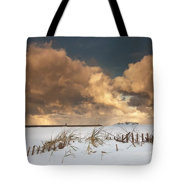 Illuminated Clouds Glowing Above A Tote Bag by John Short