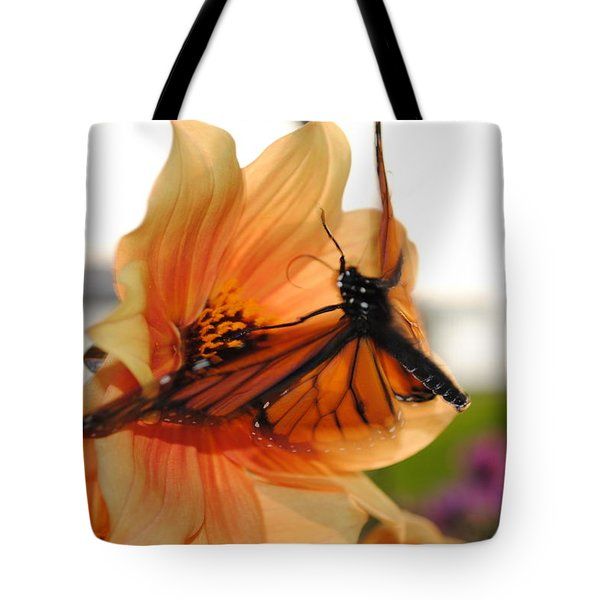 Tote Bag featuring the photograph In Flight... by Michael Frank Jr