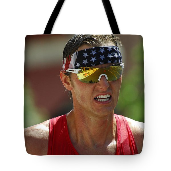 Ironman On The Run Tote Bag by Bob Christopher