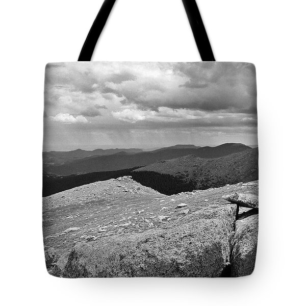 Tote Bag featuring the photograph It's Raining In The Distance by David Pantuso