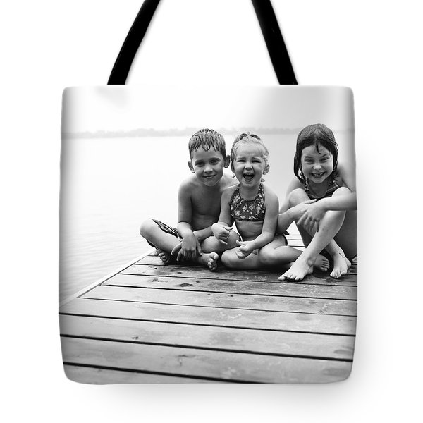 Kids Sitting On Dock Tote Bag by Michelle Quance