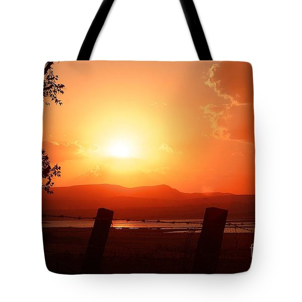 Tote Bag featuring the digital art Las Frailes Sunset by John  Kolenberg