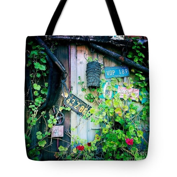 Tote Bag featuring the photograph License Plate Wall by Nina Prommer