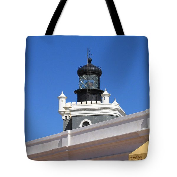 Tote Bag featuring the photograph Lighthouse At Puerto Rico Castle by Suhas Tavkar